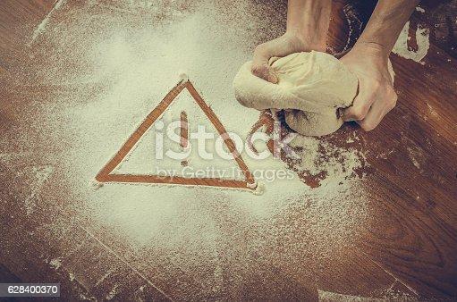 628409126istockphoto Unhealthy white flour or dough 628400370