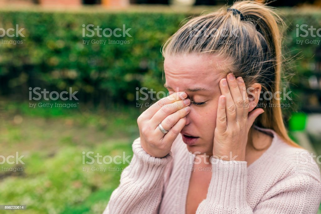 Unhealthy woman in pain stock photo