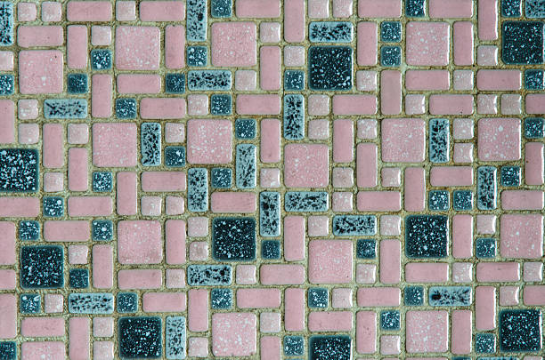 Unhygienic old dirty pink and green tiles stock photo