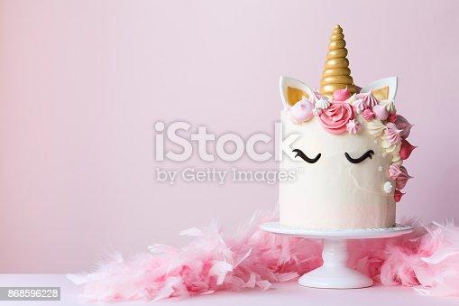 istock Unicorn cake on a cakestand 868596228
