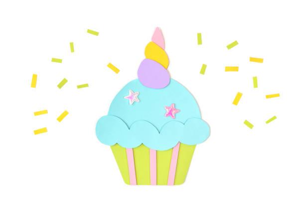 Unicorn cupcake paper cut on white background stock photo