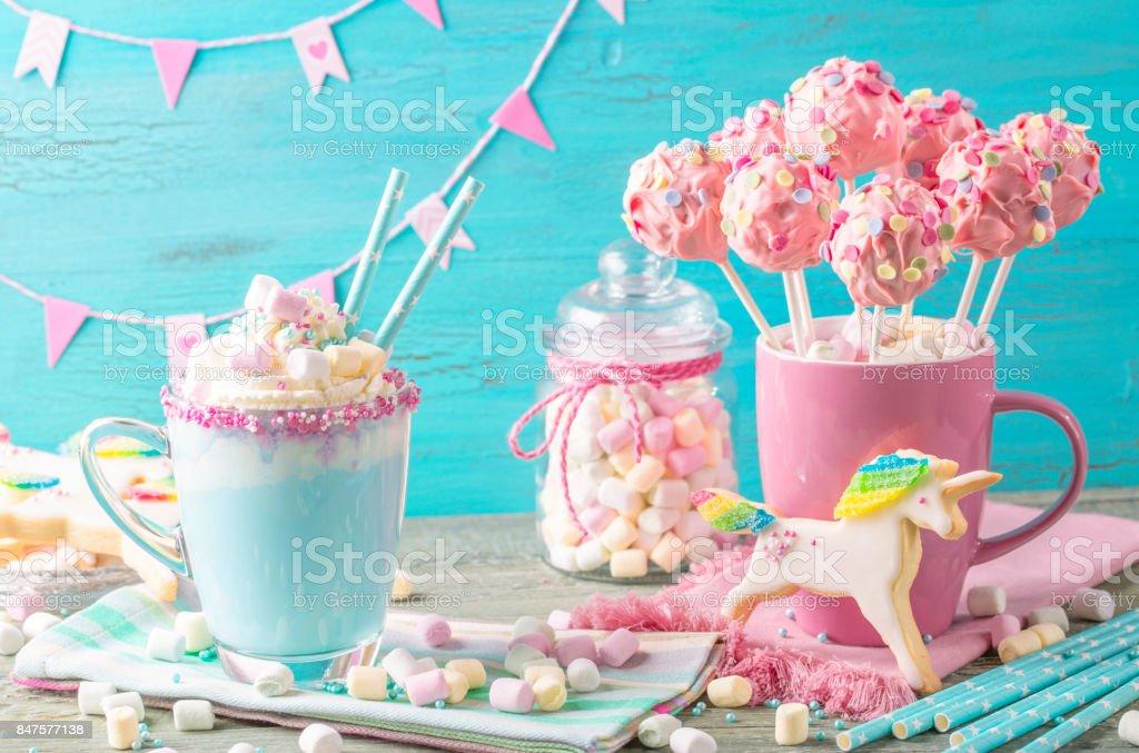 Unicorn hot chocolate and cookies stock photo