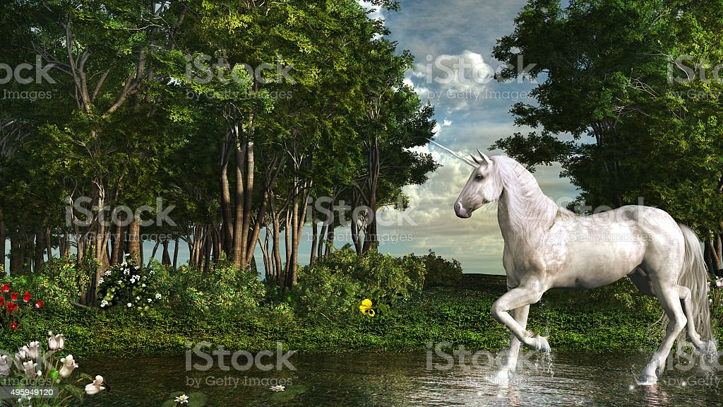 Unicorn in a magic forest stock photo
