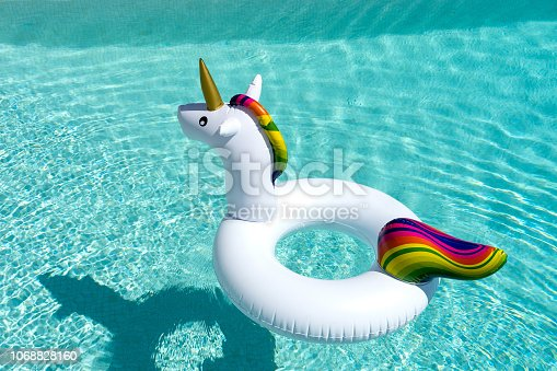 A Unicorn inflatable in the swimming pool