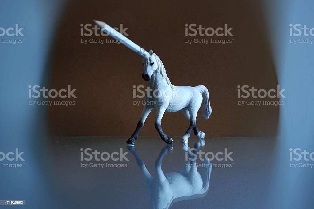 Unicorn Legend White Horse With Pencil Antler Brown Background stock photo