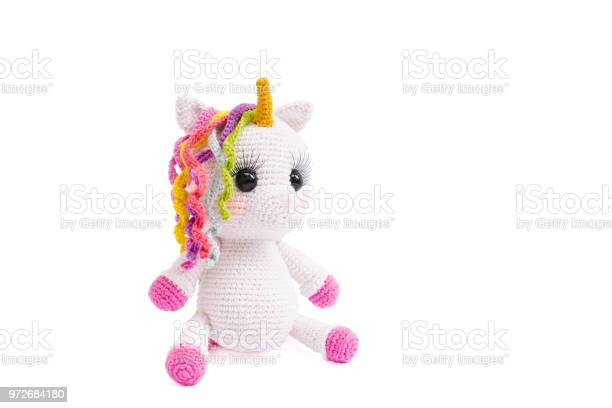 Unicorn plush doll isolated on white background a crochet doll of a picture id972684180?b=1&k=6&m=972684180&s=612x612&h=c h8rpjm8w8wxp2xhxe peq4vj0rpd41qvxueh7oun4=