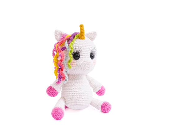 Unicorn plush doll isolated on white background. A crochet doll of a white unicorn. Amigurumi of cute stuffed animal. Unicorn plush doll isolated on white background. A crochet doll of a white unicorn. Amigurumi of cute animal. fluffy stock pictures, royalty-free photos & images