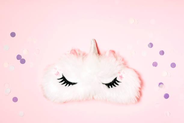 unicorn sleep mask on pink background. - unicorn bed imagens e fotografias de stock