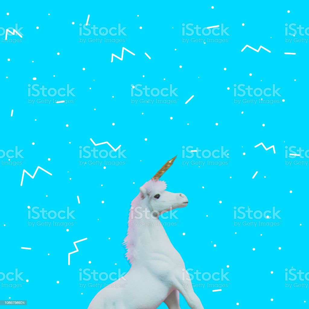 Unicorn with golden horn on blue background stock photo