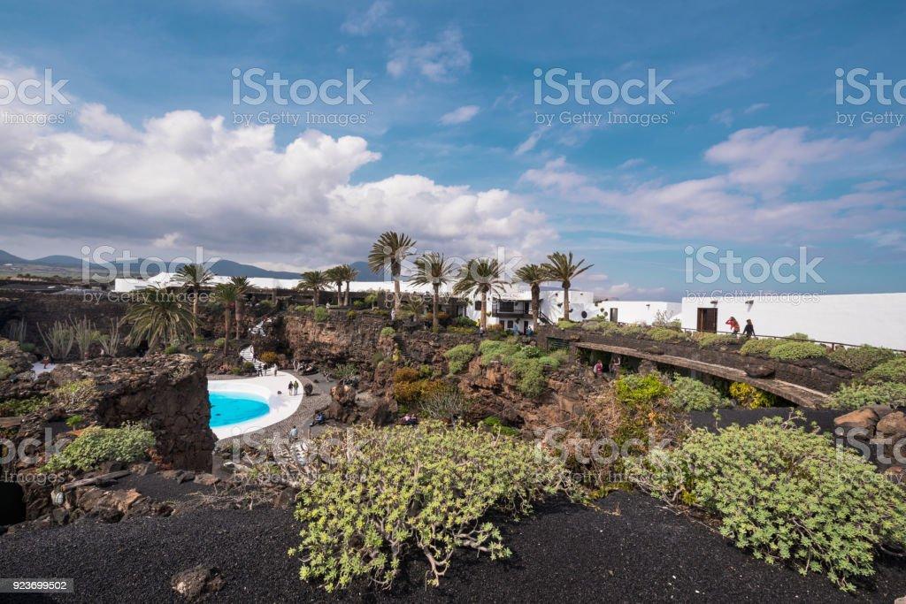 Unidentifiable Tourist visiting Los Jameos del Agua in Lanzarote. stock photo