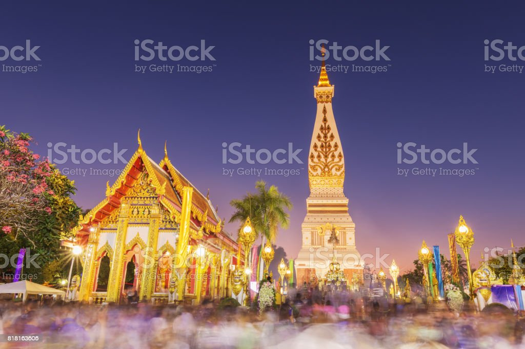 Unidentified blured people ceremony to worship at Wat Phra That phanom stock photo