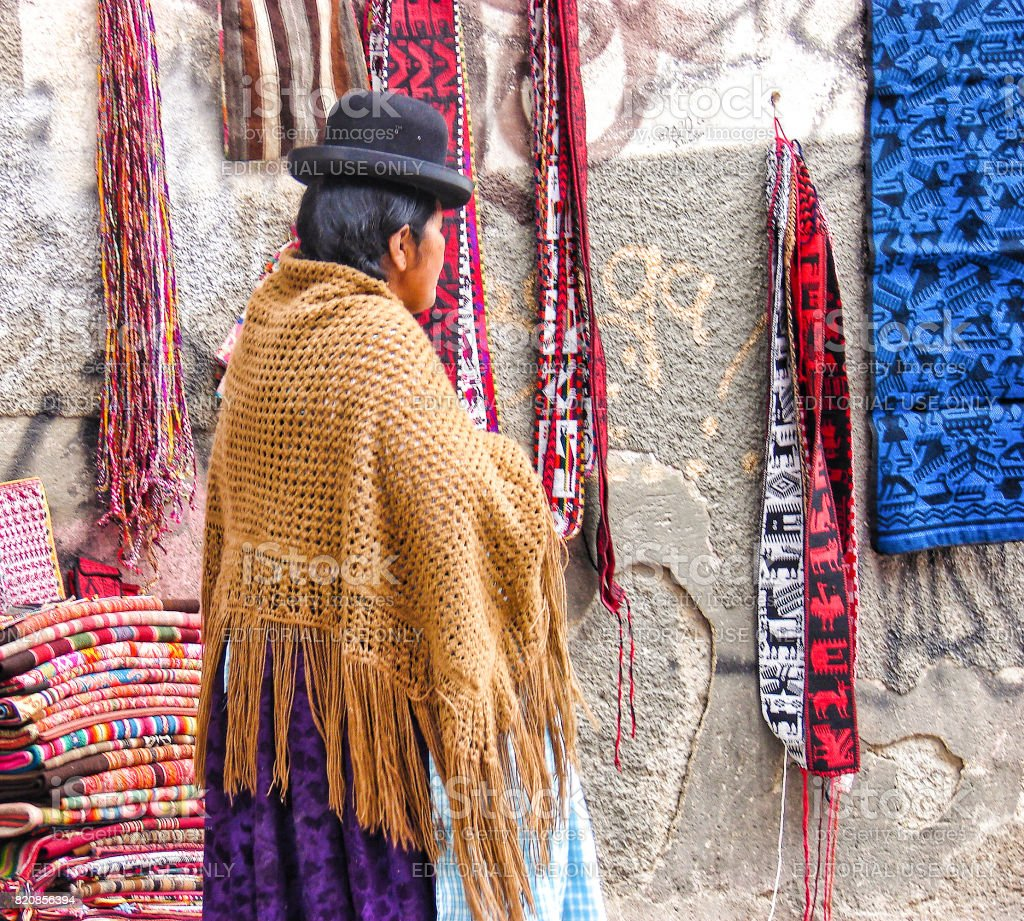 Unidentified Bolivian woman in traditional dress on the street of La Paz stock photo