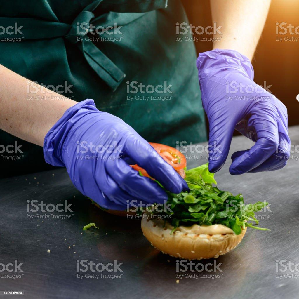 Unidentified chef preparing veggie burger with yummy vegetable p stock photo