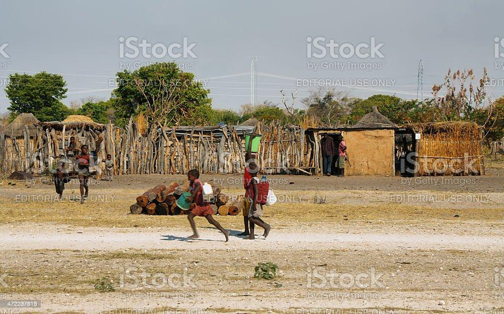 Unidentified children fetching water foto