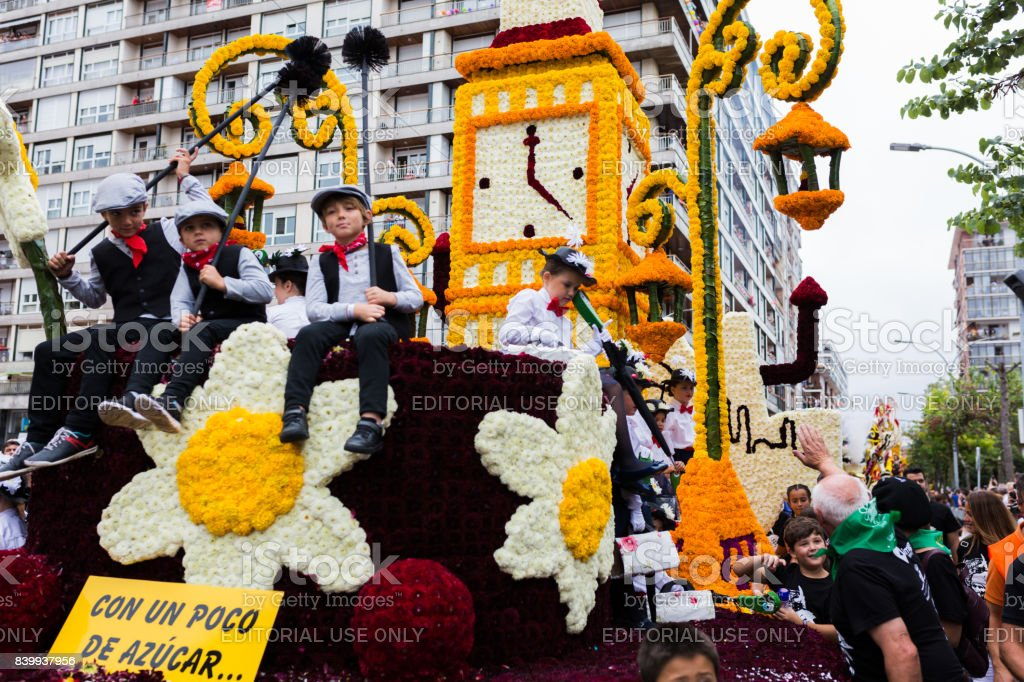 Unidentified children in a carriage with the theme of Mary Poppins in the parade of floats in the battle of flowers of Laredo, Cantabria, Spain stock photo