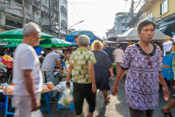 Unidentified customers are shopping at Kim Yong Market, Hat Yai, Songkhla, Thailand (motion blur) stock photo