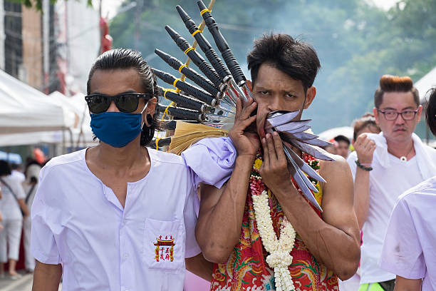 unidentified devotee of phuket vegetarian festival - knife wound stock photos and pictures