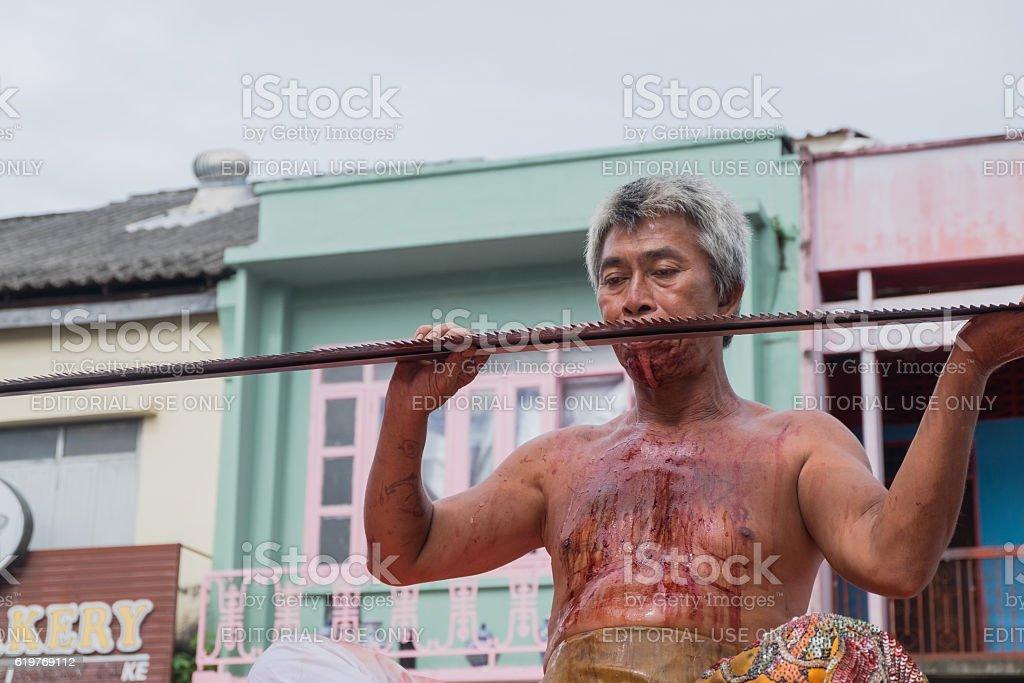 Unidentified devotee of Phuket Vegetarian Festival stock photo