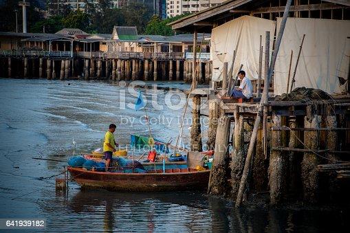 Unidentified fisherman prepare the fishing net at small boat in Sriracha, Chonburi, Thailand on 1 May 2016
