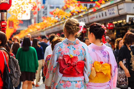unidentified foreigner tourist wearing kimono, the national tradition costume of Japan walking at Sensoji temple the famous temple in Tokyo, Japan
