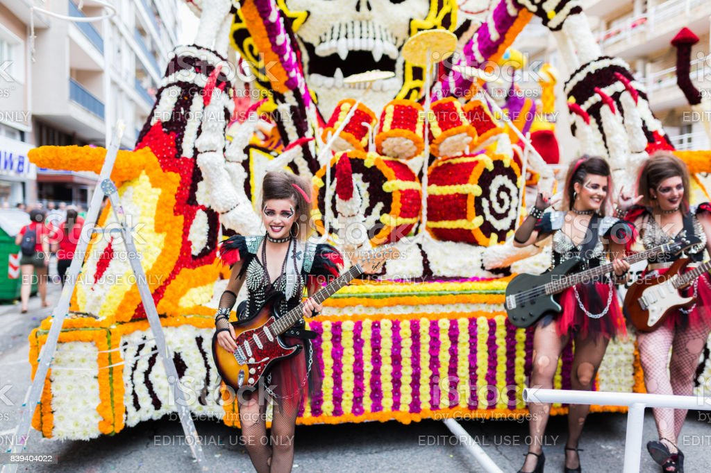 Unidentified girls dressed in rockers with guitars in the parade of floats stock photo