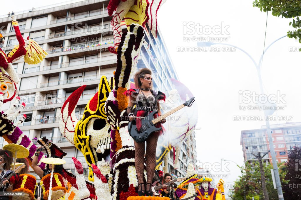 Unidentified girls dressed in rockers with guitars in the parade of floats in the battle of flowers of Laredo, Cantabria, Spain stock photo
