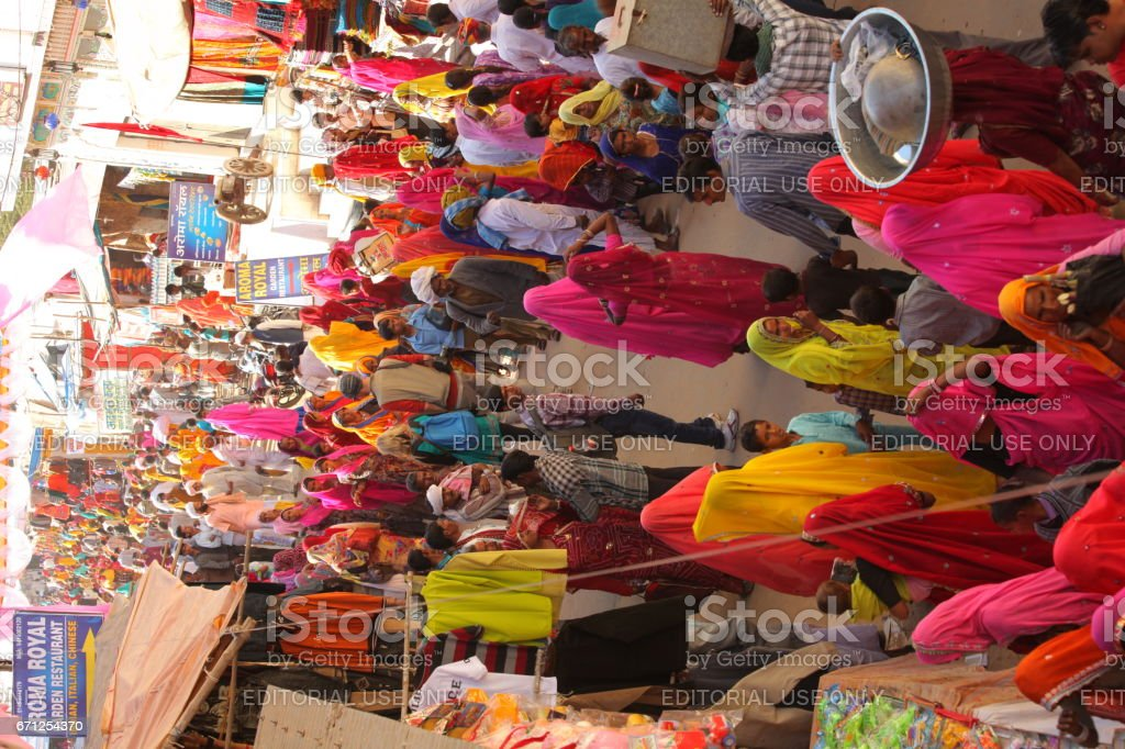 Unidentified group of people specially women folk can be seen all over the Pushkar Camel Fair stock photo