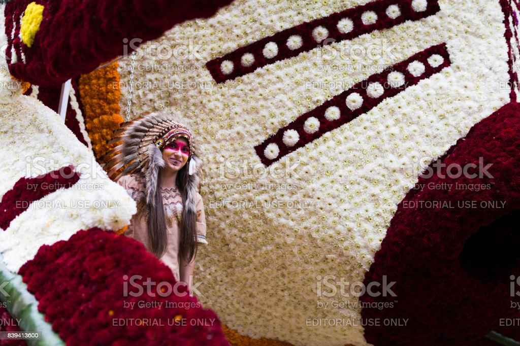 Unidentified indian girl poses before the parade of floats in the battle of flowers of Laredo, Cantabria, Spain stock photo