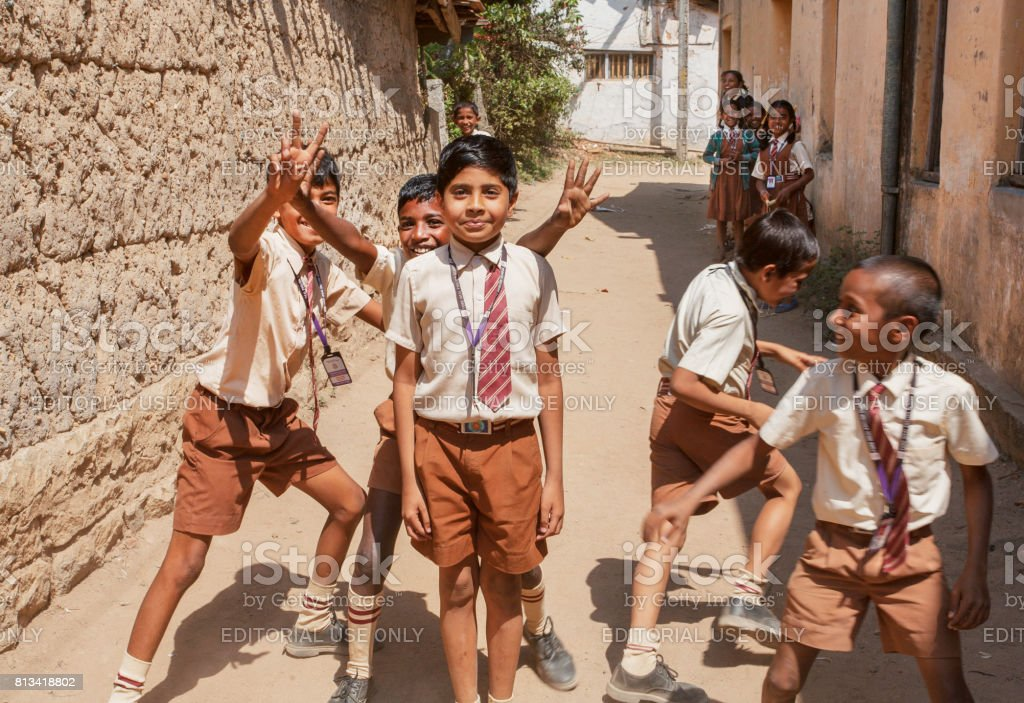 Unidentified Indian schoolkids having fun with friends in the school courtyard stock photo