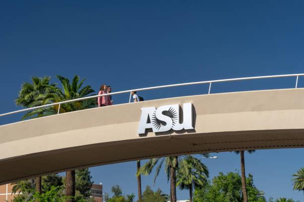 Unidentified Individuals Passing Overhead Bridge at Arizona State University stock photo