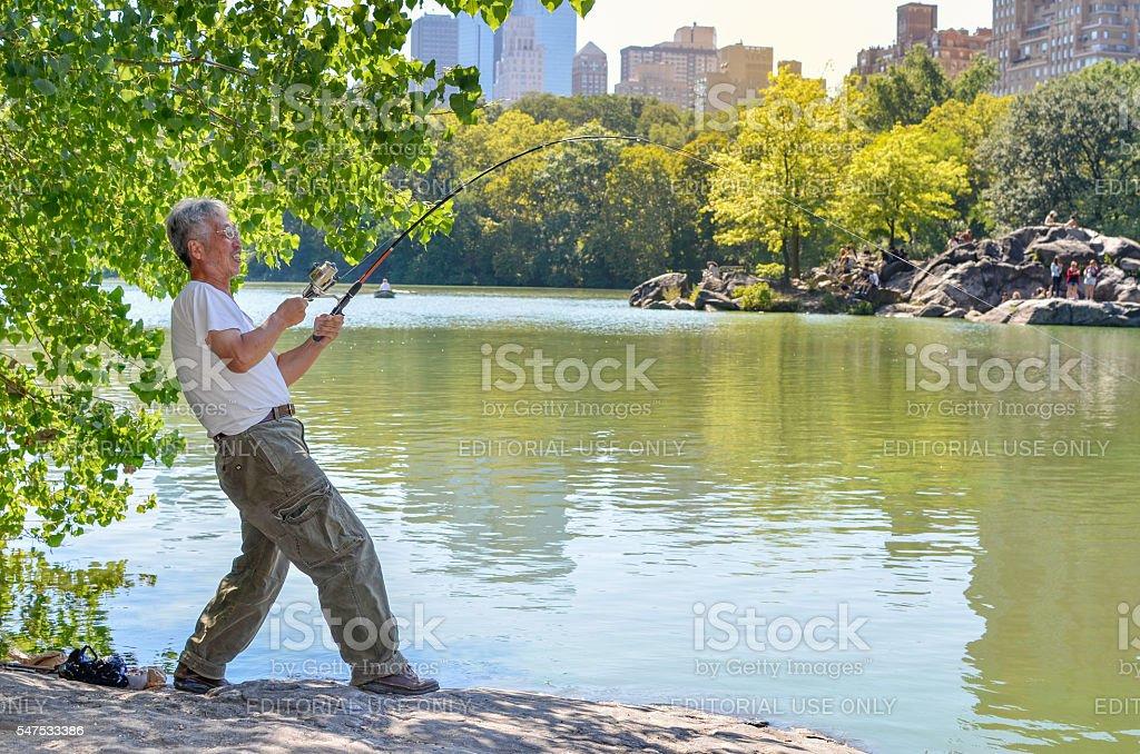 Unidentified Japanese man fishing stock photo