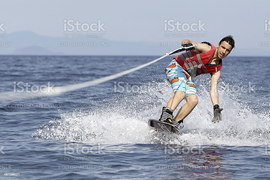 Unidentified man doing water ski on the sea in Greece stock photo