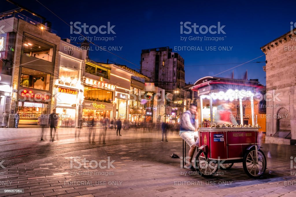 Unidentified man sells grilled chestnut at Istiklal street - Royalty-free Activity Stock Photo
