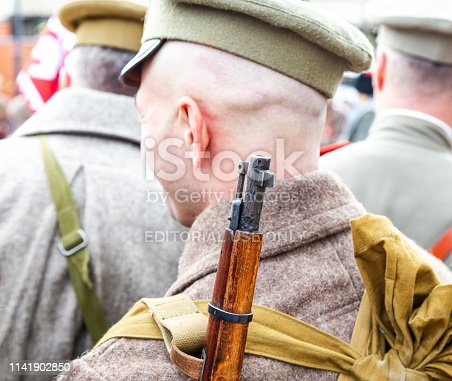 Samara, Russia - October 6, 2018: Unidentified member of historical reenactment battle in army uniform during the Russian Civil War in 1918
