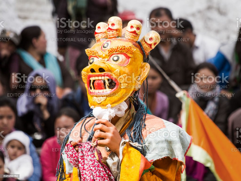 45e186639 Unidentified monk in ritual mask performs a religious masked and costumed  mystery dance of Tibetan Buddhism during the Cham Dance Festival - Stock  image .