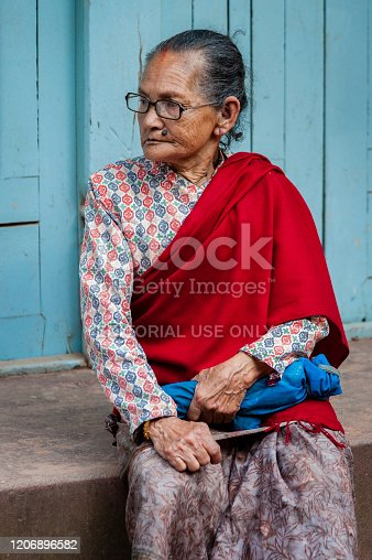 istock Unidentified Nepalese woman in Bhaktapur, Nepal, listed as a World Heritage by UNESCO for its rich culture, temples, and wood artwork 1206896582