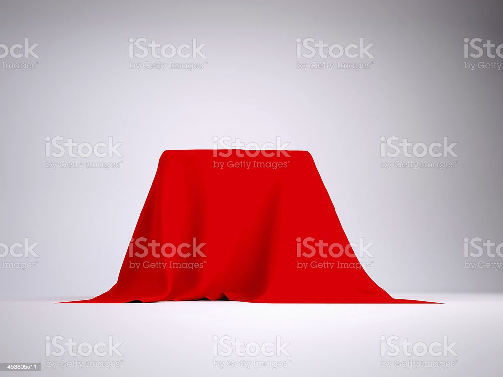 Unidentified object covered in a red tablecloth stock photo