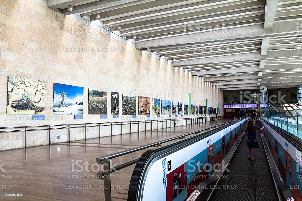 Unidentified passengers at horizontal escalator in Ben Gurion Airport stock photo