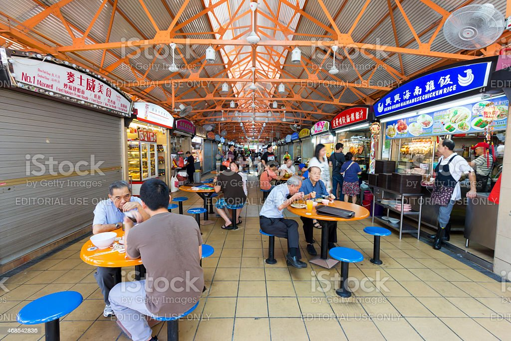 Unidentified people at food court stock photo