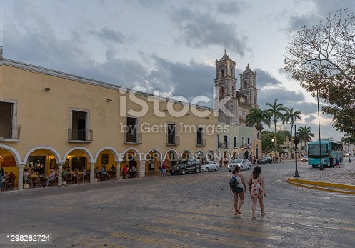 istock Unidentified people in front of the Church of San Servacio Saint Servatius in Valladolid, Yucatan, Mexico 1298262724