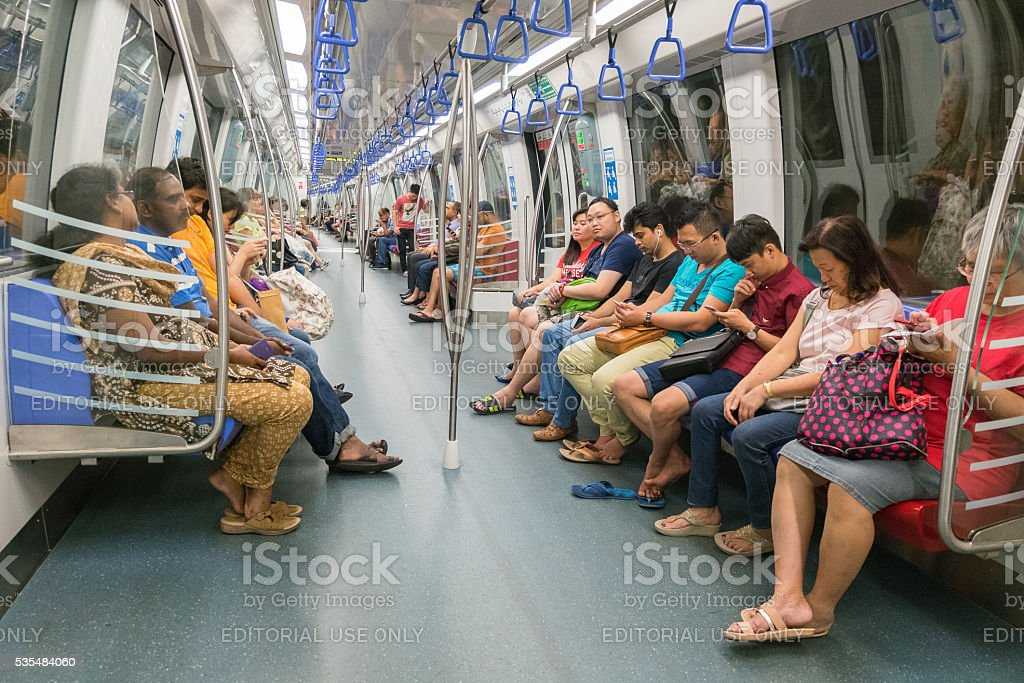 Unidentified people in MRT train in Singapore stock photo