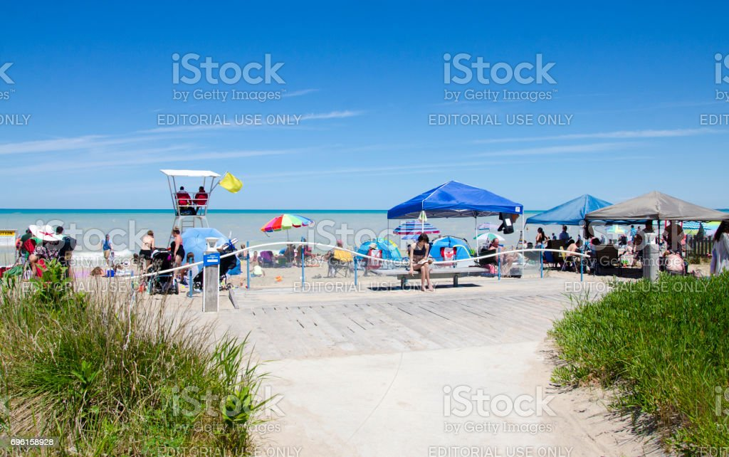 Unidentified people in the beach of the lake Grand Bend stock photo