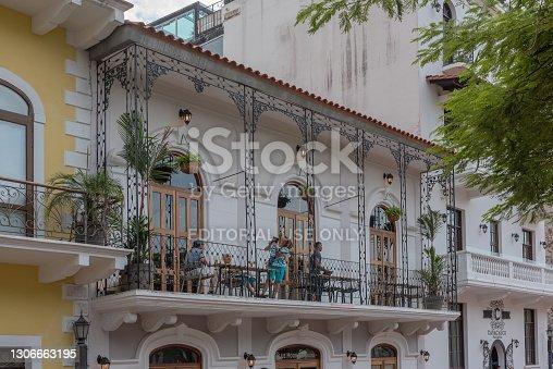 istock unidentified people on a balcony in Casco Viejo, historic center, of Panama City 1306663195