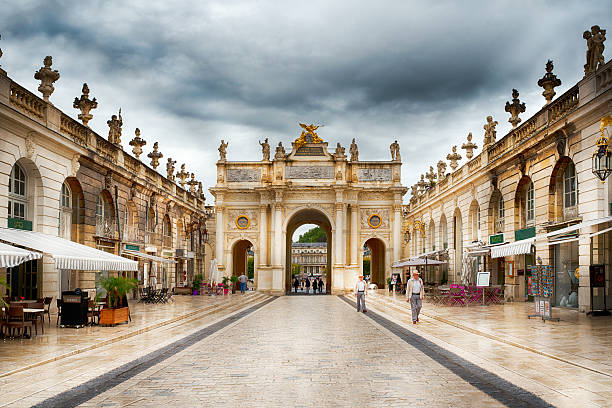 unidentified people walk at place stanislas in Nancy France Nancy, France - October 9, 2015: unidentified people walk at place stanislas in Nancy France grand est stock pictures, royalty-free photos & images