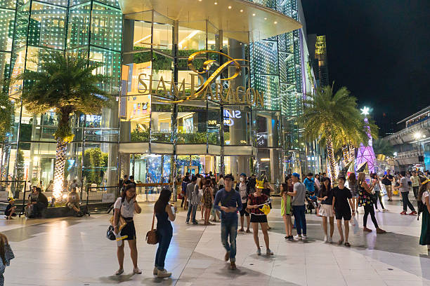 unidentified people walk at Siam Paragon shopping mall Bangkok, thailand - January 10, 2016:unidentified people walk at Siam Paragon shopping mall thailand mall stock pictures, royalty-free photos & images
