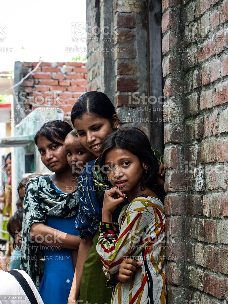 Unidentified poor people living in slum stock photo