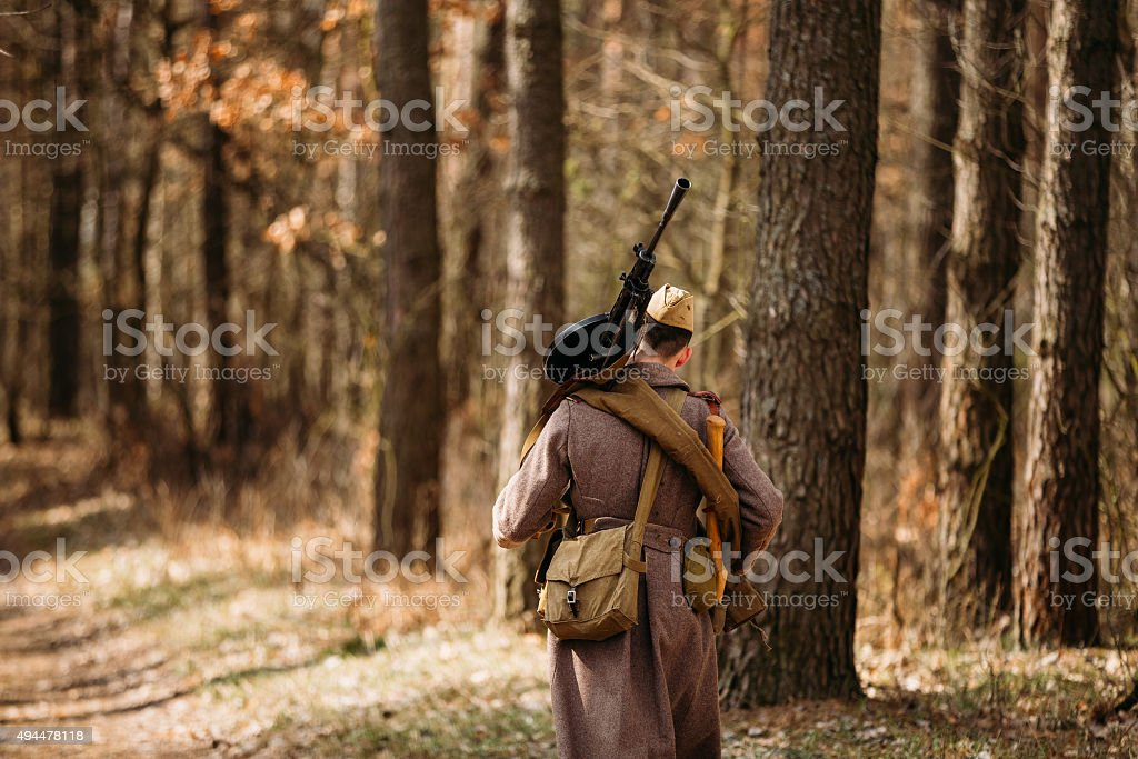 Unidentified re-enactor dressed as Soviet soldier in overcoat. stock photo