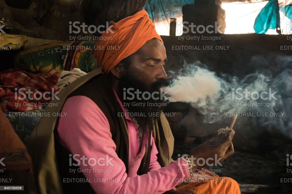 A unidentified sadhu is smoking ganja stock photo