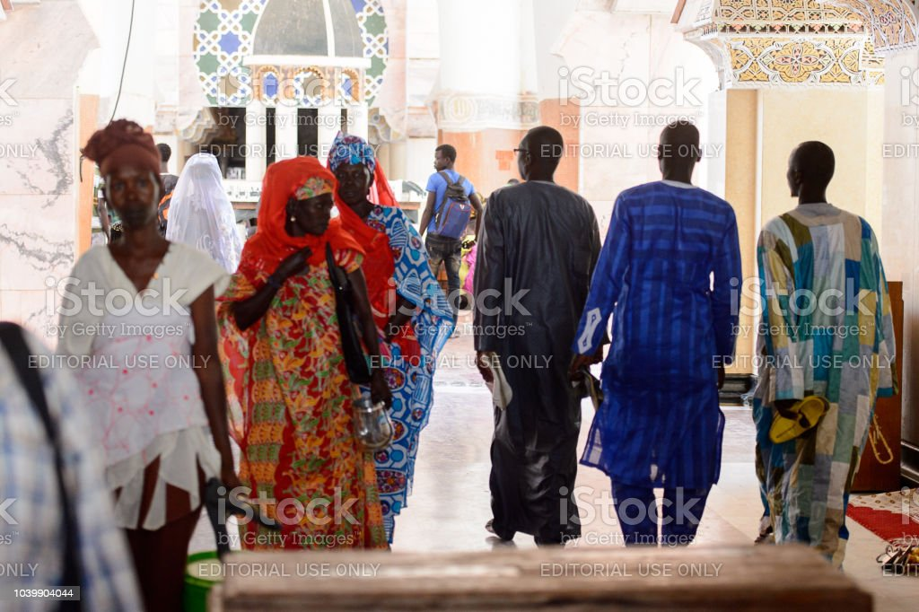 Unidentified Senegalese People In Long Traditional Clothes Walk In The  Great Mosque Of Touba The Home Of The Mouride Brotherhood Stock Photo -