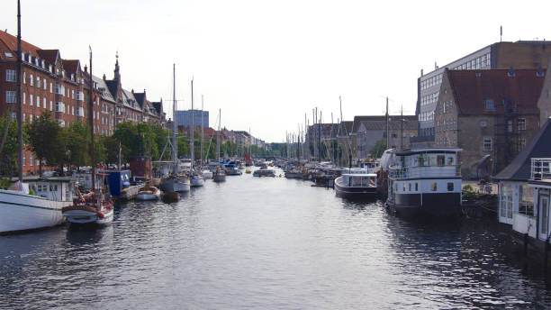 Unidentified ships on Christianshavn - canal make a sightseeing by boat through the the city stock photo